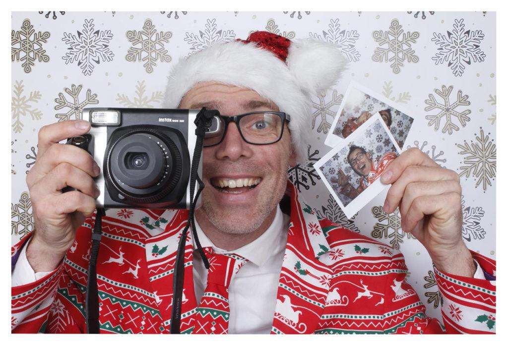 polaroid fotograaf Kerstman
